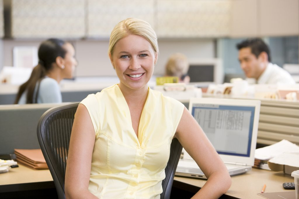 Businesswoman in Cubicle